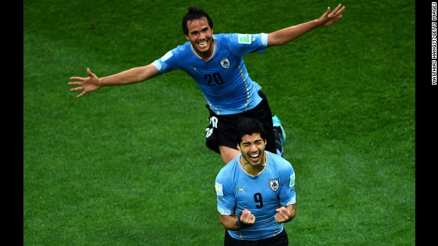 Suarez, front, and teammate Alvaro Gonzalez celebrate Suarez's first goal.