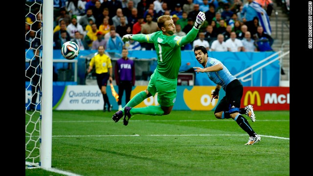 Hart can't stop Suarez's header, which came off an assist from Edinson Cavani.