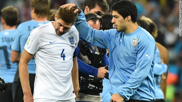 England captain Steven Gerrard, left, is consoled by Uruguay forward Luis Suarez after Uruguay won 2-1 in a World Cup match in Sao Paulo, Brazil. Gerrard and Suarez are teammates for their professional club, Liverpool.
