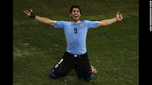 Suarez celebrates after scoring Uruguay's second goal and breaking a 1-1 tie. He had both of Uruguay's goals.