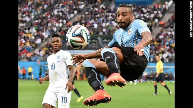 Uruguayan midfielder Alvaro Pereira jumps for the ball.
