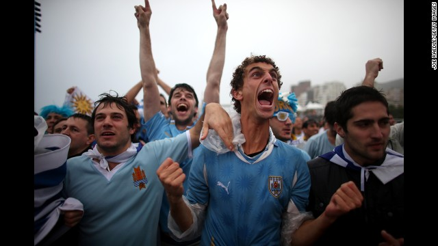 Uruguay fans at Brazil's Copacabana beach celebrate Suarez's first goal.