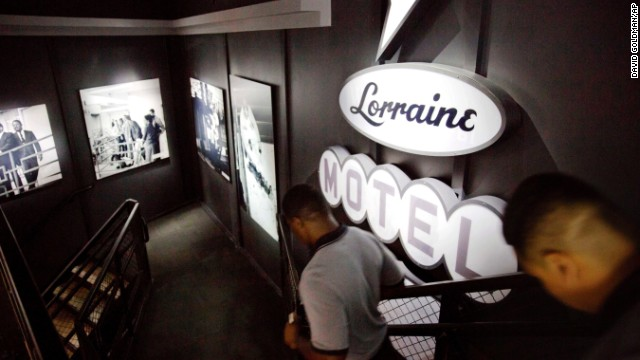 Museum workers pass through an exhibit depicting King's 1968 assassination. He was shot and killed while standing on the balcony of the Lorraine Motel in Memphis.