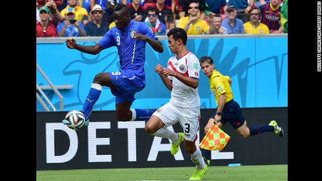 Balotelli traps the ball as he is chased by Gonzalez.