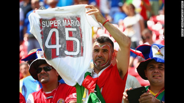 An Italy fan holds up a T-shirt honoring Balotelli before the match. <a href='http://www.cnn.com/2014/06/19/football/gallery/world-cup-0619/index.html'>See the best World Cup photos from June 19.</a>