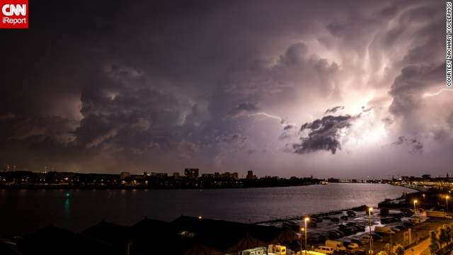 "In Antwerp, Belgium, <a href='http://ireport.cnn.com/docs/DOC-1145336'>Zachary Koulermos</a> was woken up by a hailstorm in June. After the hail subsided, the rain brought an ""amazing lightning storm,"" he said. He grabbed his camera and tripod as the clouds retreated."