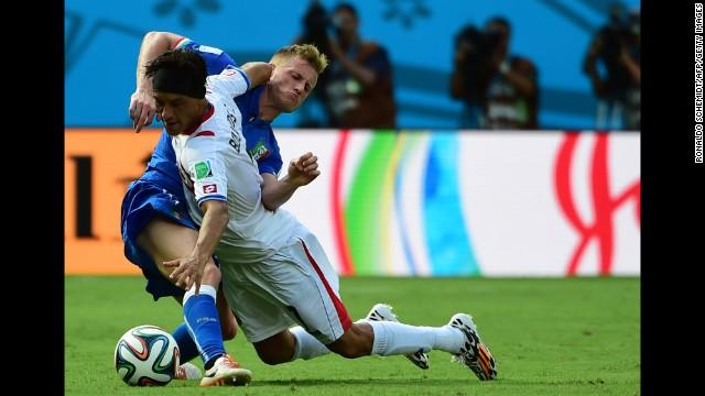Italy defender Ignazio Abate, left, challenges Costa Rica midfielder Cristian Bolanos.