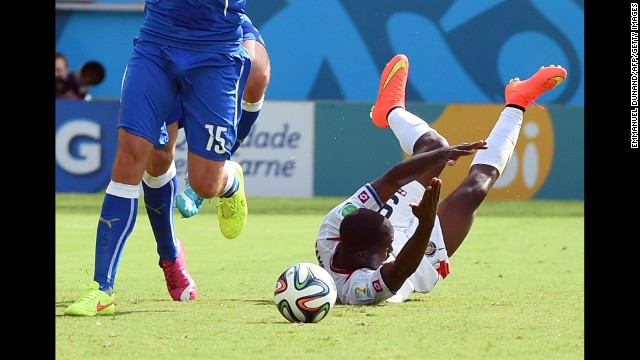 Campbell, right, falls after a tackle by Italian defender Giorgio Chiellini.