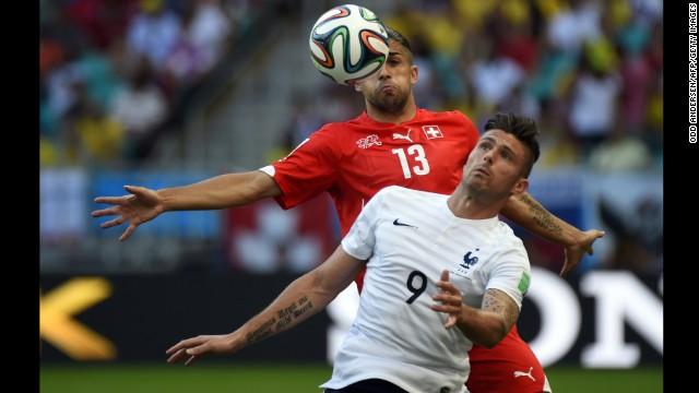 Switzerland defender Ricardo Rodriguez challenges Giroud.