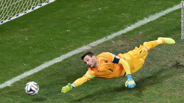 France's goalkeeper, Hugo Lloris, can't reach a free kick from Switzerland's Blerim Dzemaili.