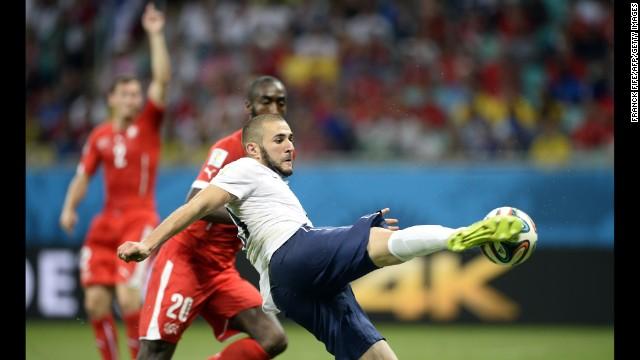 French forward Karim Benzema scores his team's fourth goal.
