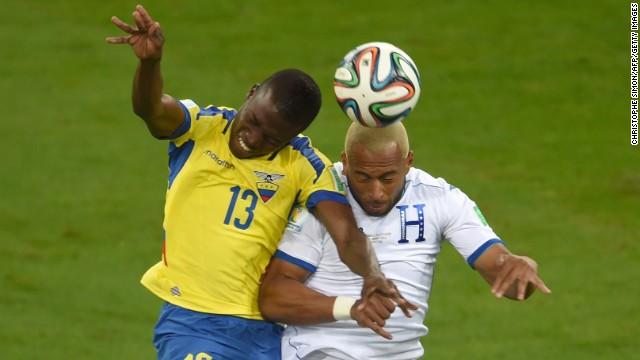 Ecuador forward Enner Valencia, left, vies with Honduras defender Victor Bernardez.