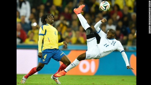 Ecuador defender Juan Carlos Paredes, left, vies with Honduras forward Jerry Bengtson.