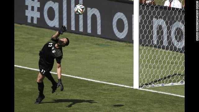 Iran's goalkeeper Alireza Haqiqi makes a save.