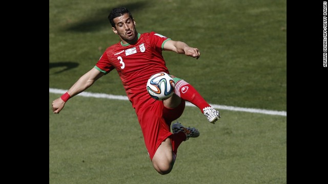 Iran midfielder Ehsan Hajsafi plays the ball.