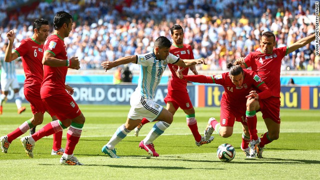 Sergio Aguero of Argentina competes for the ball against Iran.