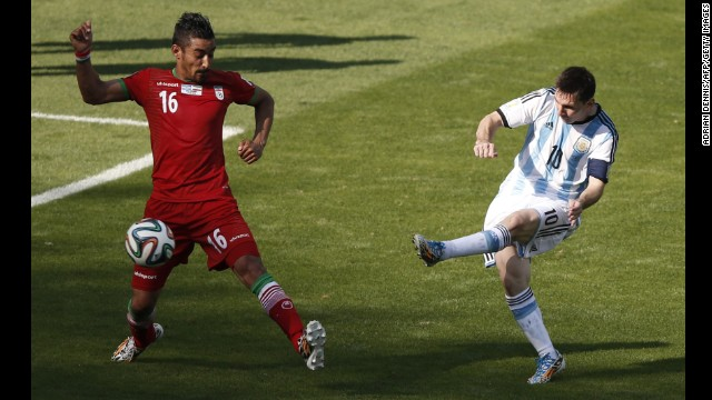 "Messi, Argentina's captain, shoots past Iran forward Reza Ghoochannejhad for the goal. ""They made the game very difficult for us,"" admitted Argentine coach Alejandro Sabella after his side's last-gasp victory."