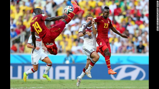 Jonathan Mensah, left, of Ghana in action.