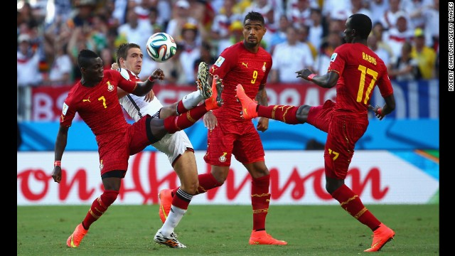Philipp Lahm of Germany competes for the ball with Christian Atsu, left.