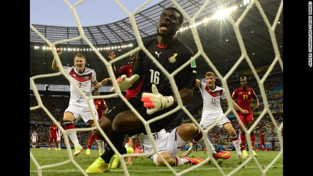 Ghana's goalkeeper Fatau Dauda reacts as he fails to save a goal.