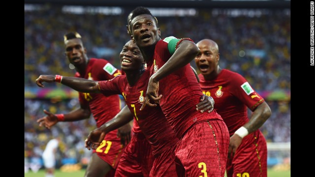 Asamoah Gyan of Ghana celebrates scoring his team's second goal with teammates. It was his fifth goal in World Cup finals, equaling the African record held by the great Roger Milla of Cameroon.