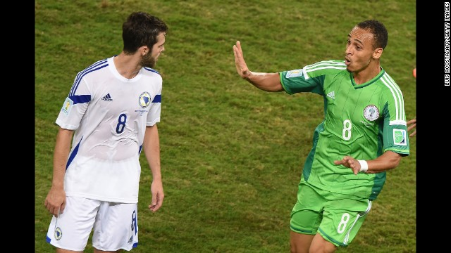 Nigeria forward Peter Odemwingie, right, celebrates near Bosnia midfielder Miralem Pjanic after scoring a goal.