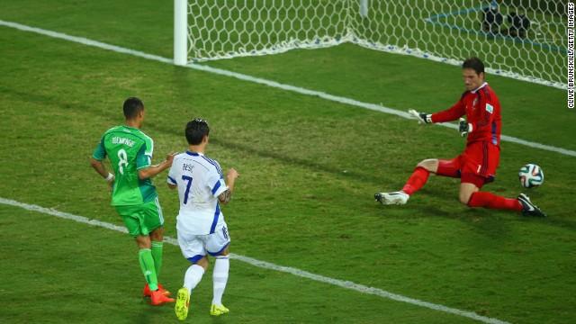 Peter Odemwingie of Nigeria scores his team's first goal past Asmir Begovic.