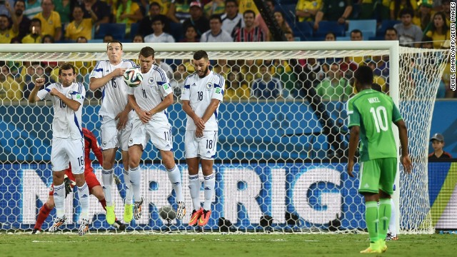 From left to right, Bosnia-Herzegovina midfielder Senad Lulic, defender Toni Sunjic, forward Edin Dzeko and midfielder Haris Medunjanin jump to block a free kick by Nigeria midfielder John Obi Mikel`.