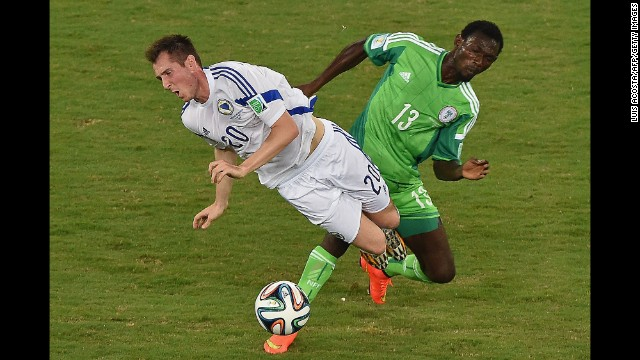 Nigeria defender Juwon Oshaniwa, right, challenges Bosnia-Herzegovina midfielder Izet Hajrovic.