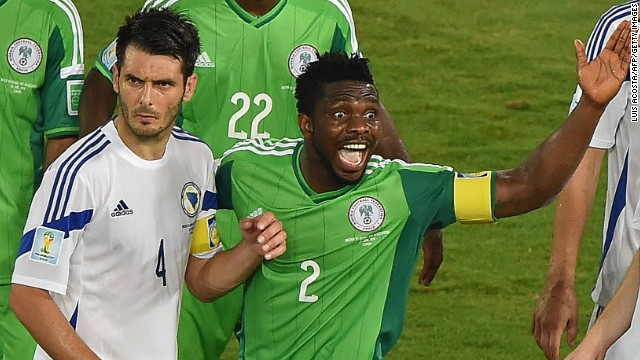 Nigeria defender Joseph Yobo gestures near Bosnia-Herzegovina defender and captain Emir Spahic.
