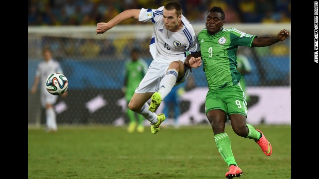 Nigeria forward Emmanuel Emenike, right, challenges Bosnia-Herzegovina defender Toni Sunjic.