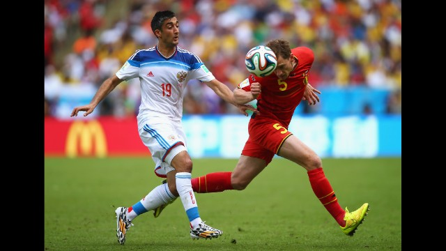 Jan Vertonghen of Belgium and Alexander Samedov of Russia compete for the ball. <a href='http://www.cnn.com/2014/06/21/football/gallery/world-cup-0621/index.html'>See the best World Cup photos from June 21.</a>