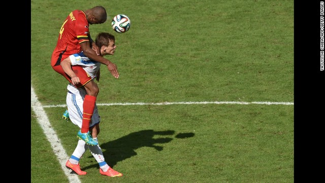 Belgian defender Vincent Kompany heads the ball past Russia's forward Alexander Kokorin.