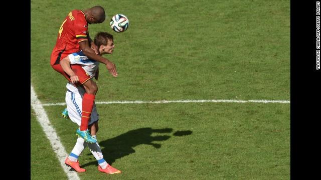 Belgian defender Vincent Kompany heads the ball past Russia's forward Alexander Kokorin.