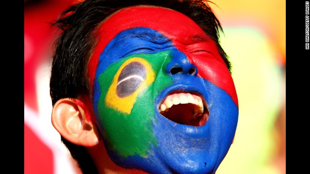 A South Korea fan cheers shows his support.