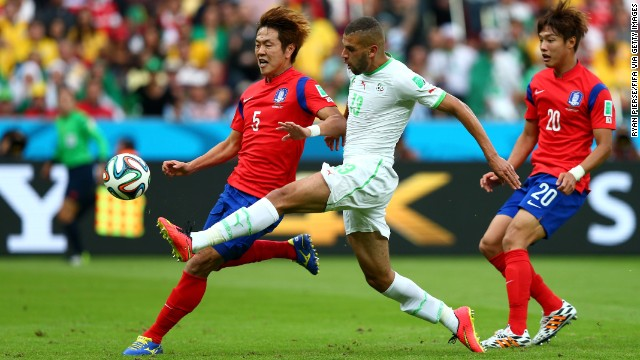 Islam Slimani of Algeria scores the first goal against South Korea.
