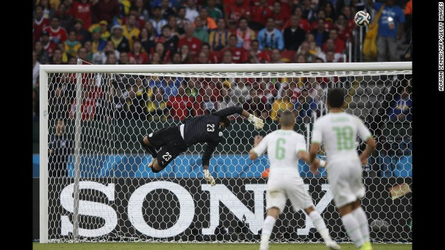 Algeria's goalkeeper Rais M'bohli makes a save.