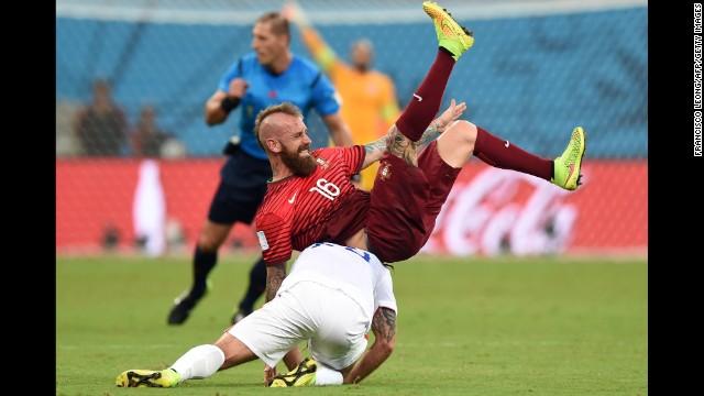 Portugal midfielder Raul Meireles and U.S. midfielder Kyle Beckerman tumble during the June 22 match in Manaus, Brazil.