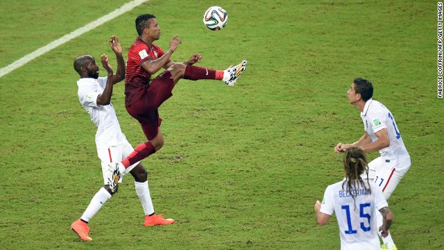 Portugal forward Nani jumps for the ball.
