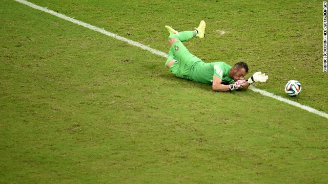 Portugal goalkeeper Beto dives for the ball. He kept the United States scoreless in the first half.
