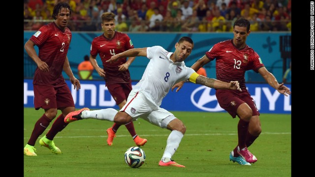 Clint Dempsey is challenged by several Portugal players during the action on June 22.