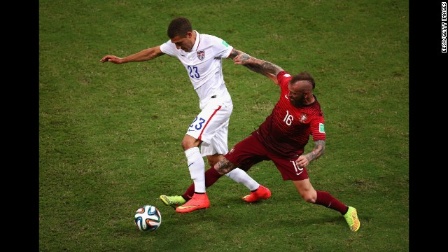 Fabian Johnson of the United States battles Raul Meireles of Portugal.
