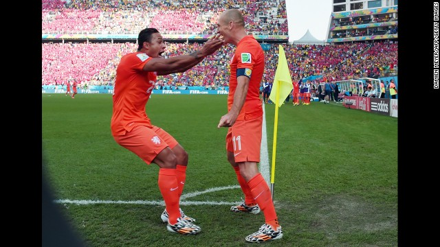 Netherlands forward Memphis Depay, left, celebrates scoring with Arjen Robben during a World Cup match against Chile in Sao Paulo. Netherlands beat Chile 2-0.