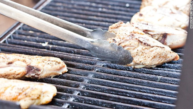 3. Move chicken, skin side down, to cooler side of grill, with thicker side of breast facing hotter side.
