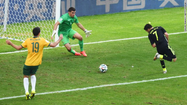 David Villa of Spain scores his team's first goal past Mathew Ryan of Australia.