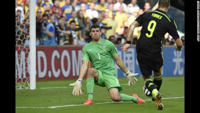 Spain forward Fernando Torres, right, scores his team's second goal.