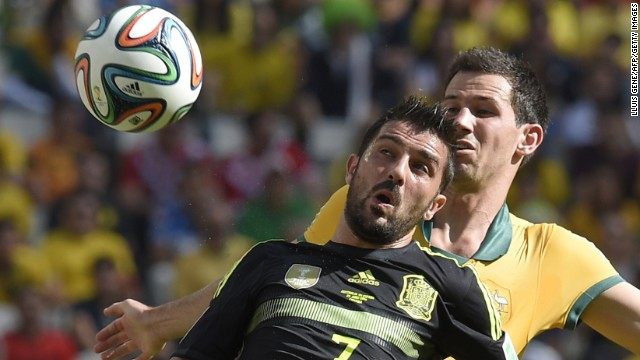 Spain forward David Villa, front, in action against Australia defender Ryan McGowan.