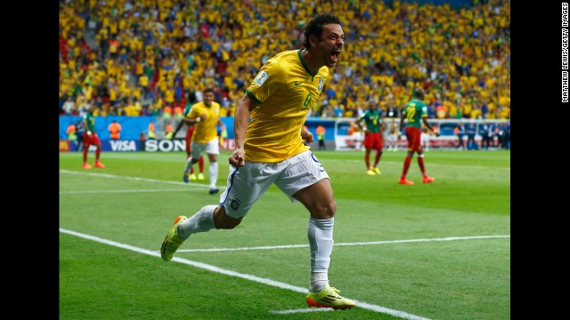 Fred of Brazil celebrates scoring his team's third goal during a match against Cameroon.