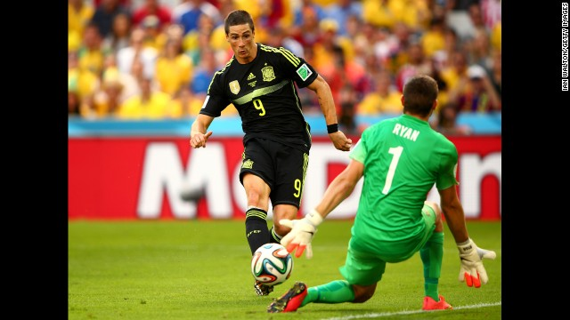 Spain's Fernando Torres scores his team's second goal past Australian Mathew Ryan.