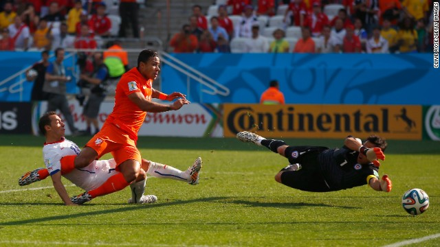 Memphis Depay of the Netherlands scores his team's second goal past Chile's goalkeeper Claudio Bravo in Sao Paulo on June 23. Netherlands won 2-0.
